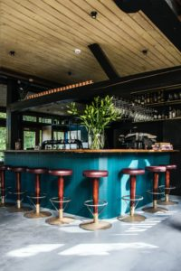 empty bar chairs during daytime